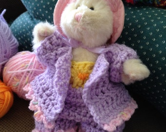Small bunny with crocheted clothes