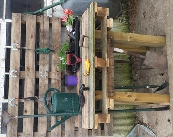 Upcycled garden work table made from reclaimed pallet wood.