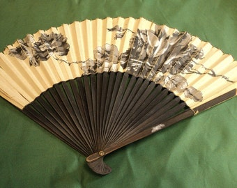 Vintage paper fan with flowers