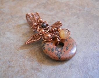 Woven copper wire & jasper donut pendant