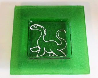 Large square plate glass of the Lochness monster
