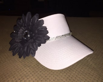 Custom sun visor with rhinestones and rhinestone centered flower.