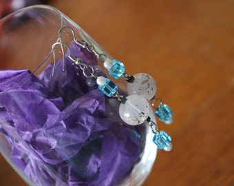 White earrings, glass earrings with brown flecks, blue accent