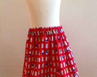 Girls skirt, red with window pattern,