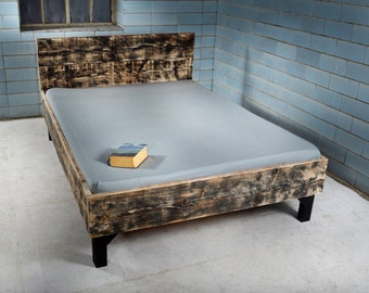 Bed with headboard from recycled lumber. VERGERS