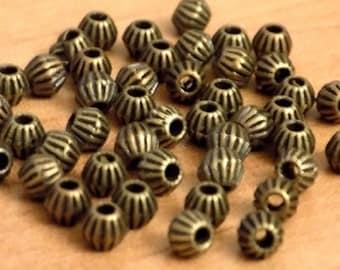 100 perles toupies décorées couleur bronze dimensions 4 mm
