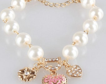 Three Jeweled Hearts and Pearls Bracelet in Gold