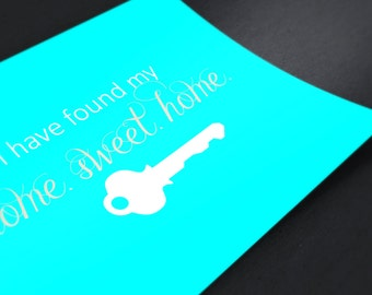 Moving Announcement with Key and Turquoise background