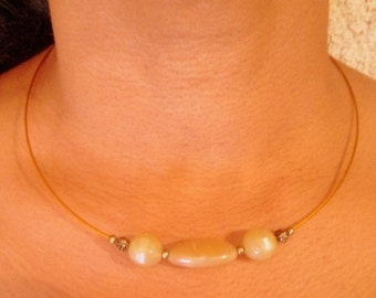 Old gold pendant with pearls candy