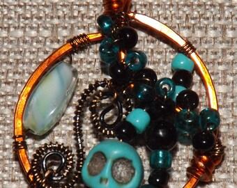 The Turquoise Skull Pendant