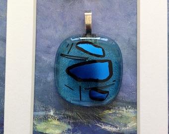 Black and blue diachroic glass pendant