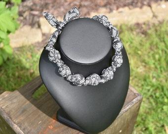 Ras grey fabric neck necklace