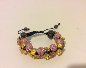 Gorgeous adjustable sterling silver gold and pink beaded flower bracelet