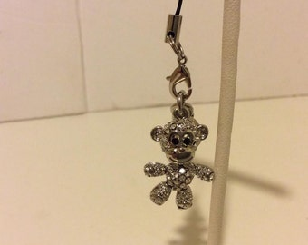 Adorable silver colored pave monkey cell phone charm