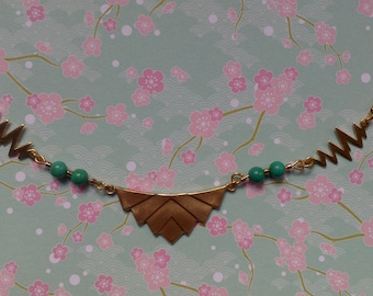 Golden and turquoise blue vintage necklace with pendant in chevrons