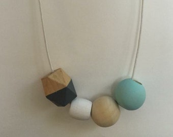 Wooden bead necklace // blue and natural // hand ;animated
