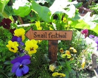 A small personalised wooden Garden Sign