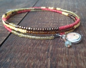 Beaded bangle bracelet with recycled wine cork charm