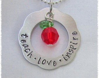 Ready to ship!  Teach love inspire hand stamped on a silver aluminum flower washer with a apple crystal charm Necklace