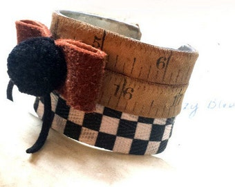 Vintage tape measure Cuff Bracelet numbers prim rustic metal  great patina taylors tape measure