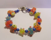 Colorful Clown Fish plus size bracelet featuring lampwork and handmade polymer clay beads