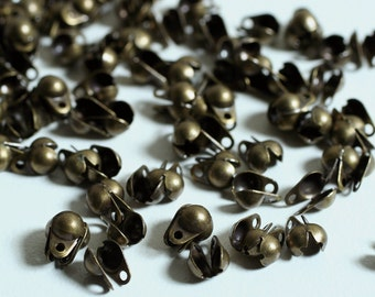 Bead tip, antiqued brass, 6.5x4.5mm side clamp-on, double-loop, 20 pcs (item ID FA1199FN)