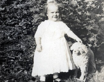 vintage photo Little Girl Martha Virginia Tomlinson Posing with her little Toy Dog RPPC