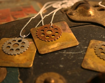 square necklace with gear