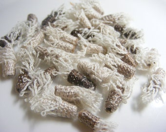 Tiny but fully grown. Don't you forget it! fiber beads, textile beads, tiny beads, tube beads, loose beads, soft jewelry beads