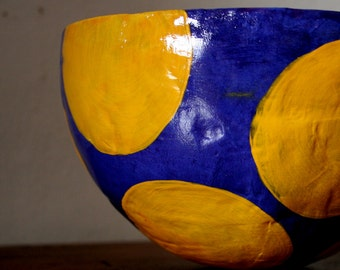 decorative papier mache bowl in bluish-purple with yellow dots