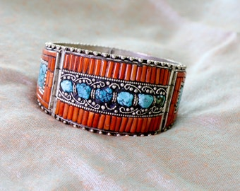 Fabulous cuff bracelet from Afghanistan of inlaid coral and turquoise chips in pewter