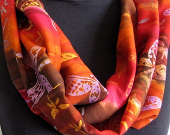 Scarf circular infinity batik printed on rayon fabric with butterflies and red rusty yellow shades of colors