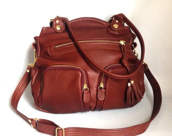 Shikotsu leather bag in russet brown