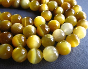 Rare Golden Blonde Tiger Eye Rounds - 8mm - half strand - 7 1/2 inches