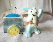 Vintage Doggie with Big Bow Sitting next to Cart Planter Pin Cushion