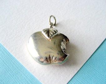 SALE..Sterling Silver Bitten Apple Pendant