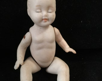 Vintage Bisque Baby Doll with Movable Arms and Legs