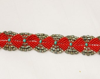"Handmade Micro Macrame Bracelet in Orange, Turquoise and Silver. 8.5"" long and 1"" wide."