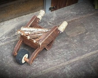 Rustic miniature wooden fairy wheelbarrow.