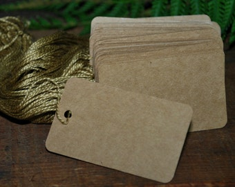"""50 Kraft Tags with Strings 2 1/2"""" X 1 1/2 """" Heavy paper"""