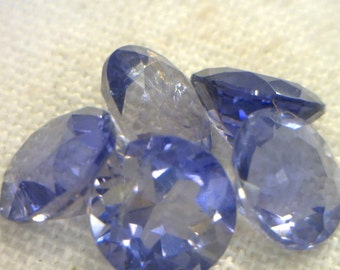 One Blue Purple Iolite 6mm Faceted Round VS Clarity Gemstone Average.70 carat
