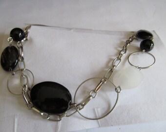 long black oval necklace