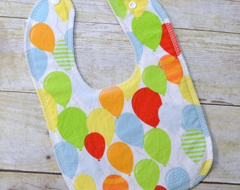 Birthday Balloons Primary Drooler Bib - Snap - Non wicking fleece back - Middle layer Organic cotton