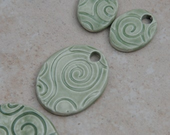 Handmade Pottery Beads 4 piece set, in a smaller Elli cuff with matching beads for earrings and a pendant in Green Tea