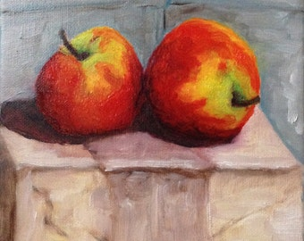 Still Life of two apples on a Cardboard Box