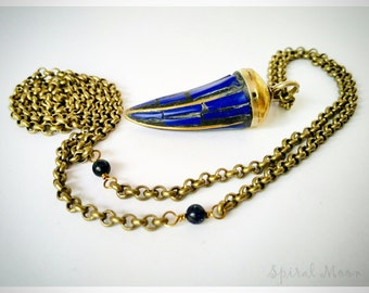 Blue stone tooth pendant, goldstone bead, and brass chain necklace, long one-piece
