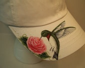 Women's White Ball cap with a hand painted Hummingbird