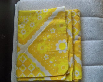 pair of  bright yellow white  and mustard  vintage pillowcases