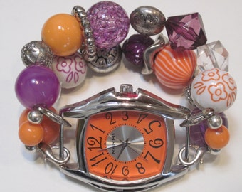 Phoenix Suns themed orange, purple, white, clear and silver plated acrylic beaded watch band. Includes orange watch face