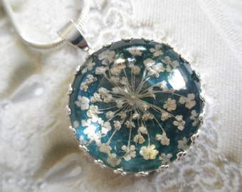 Queen Anne's Lace Pendant Beneath Glass Atop Rich,Glowing Teal Background Pressed Flower Crown Pendant-Symbolizes Peace-Gifts Under 25